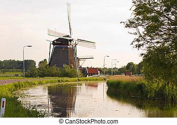 Dutch windmills with reflection