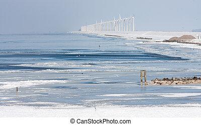 Dutch winter seascape with big farm of windturbines