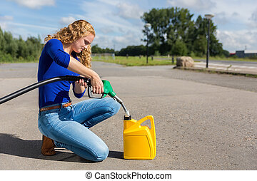 Dutch woman fueling jerrycan with petrol hose