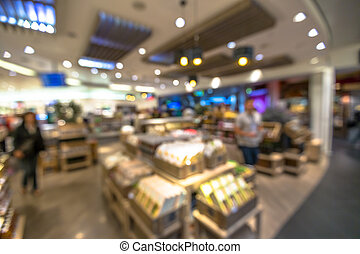 Duty Free - People in the duty free shop at the airport. ...