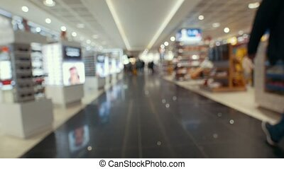 Duty free store in international airport - blurred