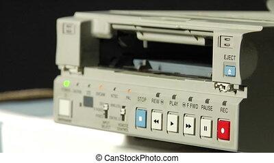 dv-cam deck - process of the ejecting digital dv-cam cassete...