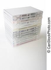 DVD boxes - Stacked dvd jewel case boxes on white background...