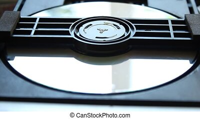 DVD player. Inside a DVD player. Download and extract the DVD disc from the player. DVD disk.