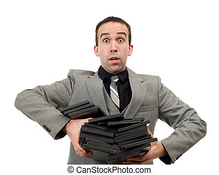 DVD Rentals - A man wearing a suit carrying an armful of dvd...