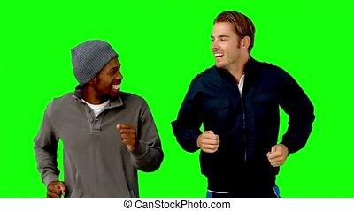 dwa mężczyzn, wyścigi, na, zielony, ekran