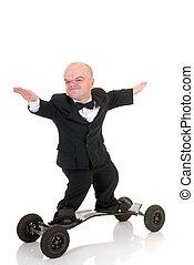 Dwarf, surfing to success - Little businessman, dwarf in a ...