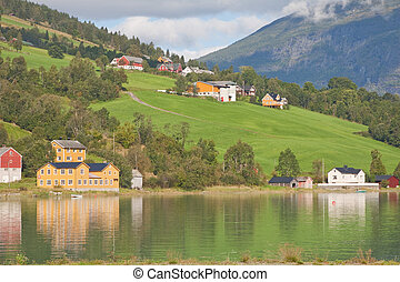 Dwellings along the banks of the Nordfjord in Olden, Norway