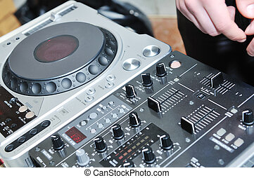 dy hand closeup on party - dj equipment gramophone and...