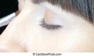 Dye the eyes of the model - Make-up artist dye the eyes of...
