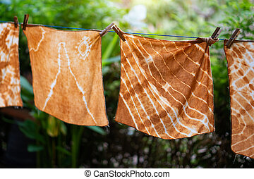 Dyed batik cloth hanging in the outdoor garden.