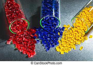 dyed plastic resin im laboratory - blue, red and yellow...