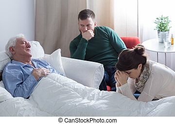 Dying man lying in bed
