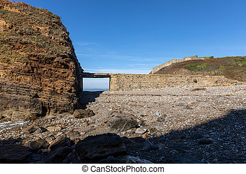 Dyke bridge in ruins towards an old electric factory on the ...