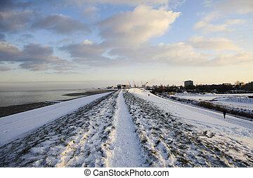 dyke in winter - snowy dyke in holland
