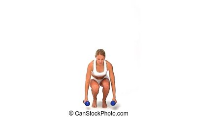 Dynamic blond woman with dumbbells