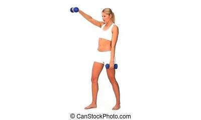 Dynamic blonde woman in sportswear