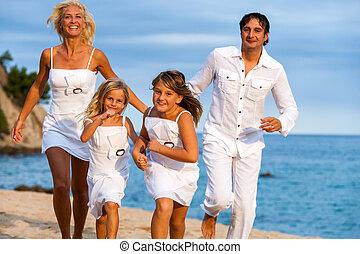 Dynamic family running on beach.
