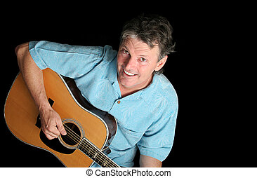 Dynamic Guitarist on Black - A handsome middle aged guitar...