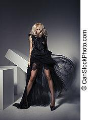 Dynamic image of a beautiful woman shot in studio
