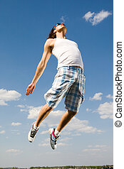 Dynamic lad - Image of energetic man jumping high against...