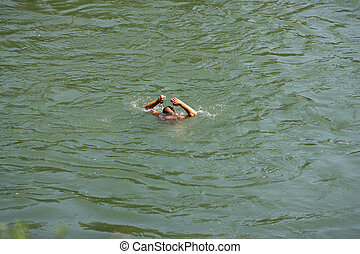 Dynamic Photo Of A Man Diving Into The Water For A Swim