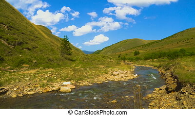 Dynamic sky over valley with a river in caucasus mountains,...