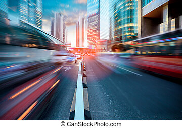 dynamic street in modern city, dusk traffic in shanghai
