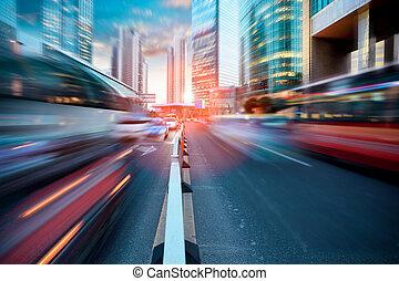 dynamic street in modern city,dusk traffic in shanghai