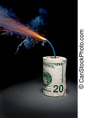 A roll of cash made into a dynamite stick has a lighted fuse throwing smoke and sparks before it explodes.