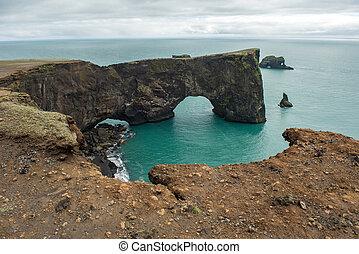 Dyrholaey rock arch in the Atlantic ocean, Iceland