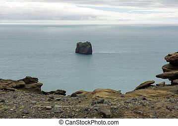 Dyrholaey rocks in the Atlantic ocean, Iceland