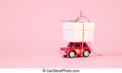 dzień, wstążka, boks, różowy, wóz, doręczenie, zabawka, dar, retro, dzień, valentine, video, łuk, tło., czerwony, damski, urodziny, concept.