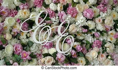 E and E letters at flowers background