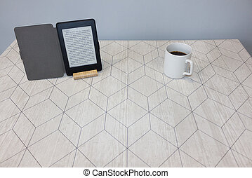 E-book and a cup of coffee