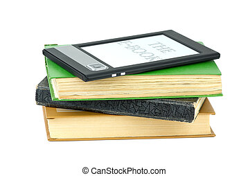 E-book reader and classic paper books isolated on the white...
