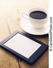 E-book reader and coffee - E-book reader and coffee cup with...