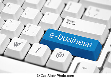 e-business key on a white keyboard closeup. E-business concept image.