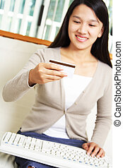 E-commerce - A businesswoman making an online purchase