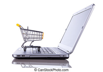 E-commerce concept - shopping-cart over a laptop isolated on...