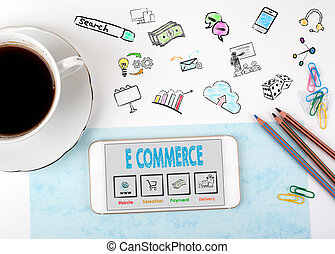 E commerce. Mobile phone and coffee cup on a white office desk