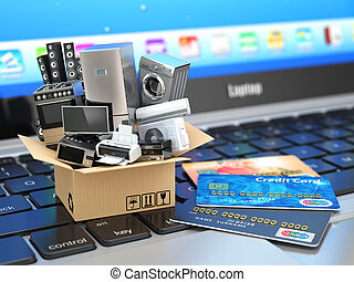 E-commerce or online shopping or delivery concept. Home appliance in box with credit cards on the laptop keyboard.