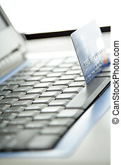 E-commerce - A shot of a laptop and a credit card in an...
