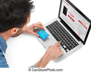 E-commerce - Man shopping online from a laptop with a credit...