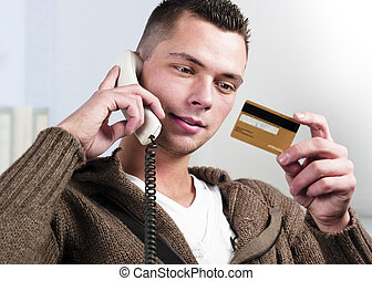 e-commerce via telephone - Smiling young businessman having...