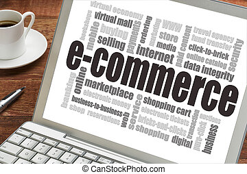e-commerce word cloud on a laptop screen with a cup of coffee - internet business concept