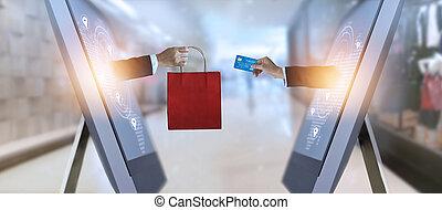 e-commerz, hand holding, einkaufstüte, und, kreditkarte, von, schirm, und, gesamt-netzwerk, shoppen, und, zahlungen, online, begriff
