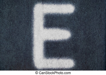E isolated chalk letter in blackboard background