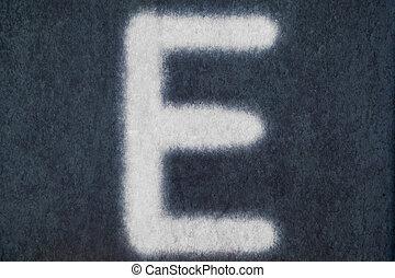E isolated chalk letter in blackboard background