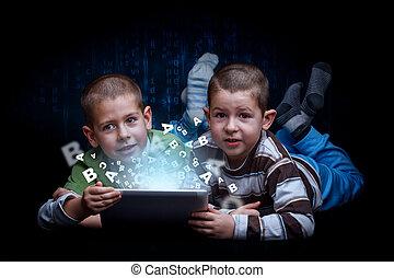 E-learning concept. Boys using digital tablet